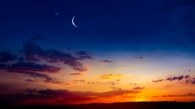 New moon. Prayer time. Generous Ramadan. Mubarak background. A decline or rising with clouds. Light from sky . Religion background . The sky at night with stars stock image