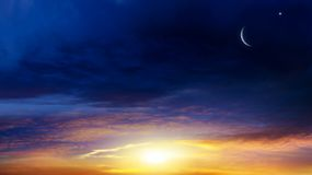 New moon. Prayer time. Generous Ramadan. Mubarak background. A decline or rising with clouds. Light from sky . Religion background . The sky at night with stars stock photos