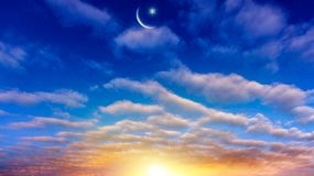 New moon. Prayer time. Generous Ramadan. Mubarak background. A decline or rising with clouds. Light from sky . Religion background . The sky at night with stars royalty free stock image