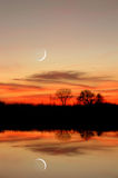 New Moon Reflection. New Moon, Sunset, and Riparian Tree Reflection over Still Riparian Slough in Wildlife Preserve, Sacramento Delta, Central Valley, California Stock Images