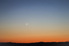 New moon at sunset Stock Image