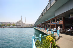New Mosque, Galata bridge and restaurants Stock Photos
