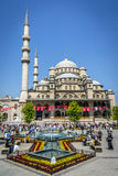 New Mosque of Istanbul. New mosque, view from square with flowers and people Royalty Free Stock Photos