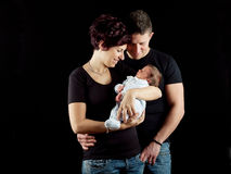 New mother with baby and husband Royalty Free Stock Photos