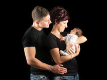 New mother with baby and husband Stock Photo