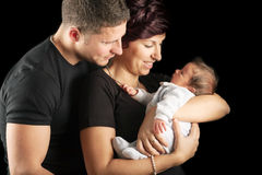 New mother with baby and husband Stock Photos