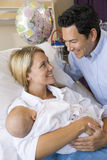 New mother with baby and husband in hospital Stock Image