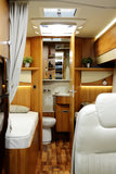 New motor home inside view. View inside a new motor home camper with interior and decoration around. Its a brand new model with plenty of space indoors Stock Image