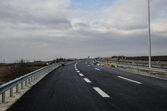 New motorway under construction with clouds. New motorway under construction with dramatic clouds royalty free stock photo