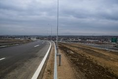 New motorway under construction with clouds. New motorway under construction with dramatic clouds stock image