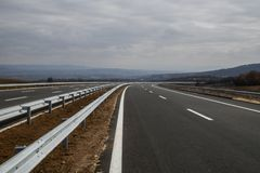 New motorway under construction with clouds. New motorway under construction with dramatic clouds stock photo