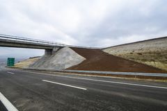 New motorway under construction with clouds. New motorway under construction with dramatic clouds royalty free stock photography