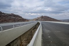 New motorway under construction with clouds. New motorway under construction with dramatic clouds stock images