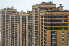 New multi houses built of brick, and multiple windows Royalty Free Stock Photos