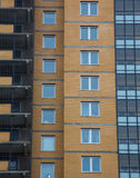 New multi houses built of brick, and multiple windows Royalty Free Stock Photo