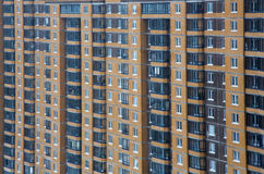 New multi houses built of brick, and multiple windows Stock Photos