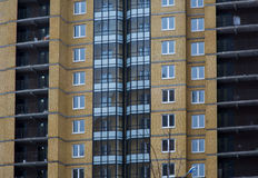 New multi houses built of brick, and multiple windows Stock Photo