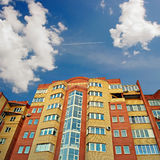 The new multi-storey building against the blue sky. Royalty Free Stock Photo