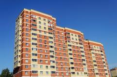 New multi-storey orange dwelling house Royalty Free Stock Image