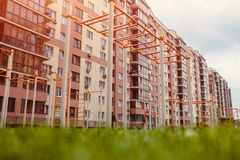 New multi-storey residential building. Sports ground with lawn in front of the house Stock Photo