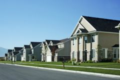 New neighborhood. A street of newly built homes in a typical American suburban community Royalty Free Stock Photography