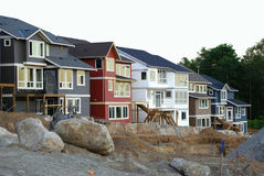 New Neighborhood. Row of new houses being constructed as part of a new neighborhood Stock Photo