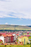 New neighborhood in Floresti, Cluj. FLORESTI, ROMANIA — JUNE 14, 2014: Scenic view at new neighborhood and hills under beautiful sky, Cluj, Transylvania Royalty Free Stock Image