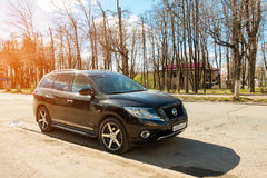 New Nissan Pathfinder parked in suburbia street of Smolensk City. Smolensk, Russia - April 24, 2017: New Nissan Pathfinder parked in suburbia street of Smolensk Royalty Free Stock Photos