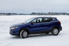 New Nissan Qashqai 2019 model color ink blue in snowy winter landscape. stock image