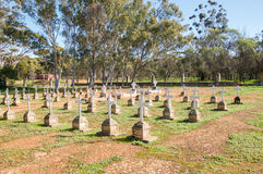 New Norcia Cemetery Crosses. NEW NORCIA,WA,AUSTRALIA-JULY 15,2016: Peaceful New Norcia Cemetery with gravestones in ordered rows with crosses in the treed Royalty Free Stock Images
