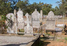 New Norcia Cemetery: Headstones. NEW NORCIA,WA,AUSTRALIA-JULY 15,2016: Rear view of Headstones in garden fencing at the New Norcia Cemetery with treed landscape stock image