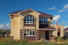 New not populated two-storeyed brick house Stock Photography