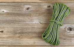 New nylon climbing rope on rustic wooden boards Stock Image