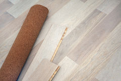 New oak parquet. And soundproof cork substrate stock photography