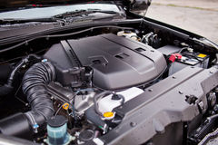 The new off-road vehicle`s engine V8 is covered with plastic.  Stock Photo