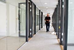 New office. Office under construction, worker walking in a corridor Stock Photo