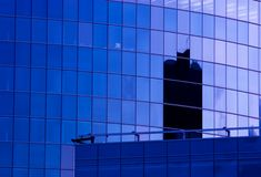 New office building facade. Blue corporate office building facade and reflection of other skyscraper in late evening Royalty Free Stock Photo