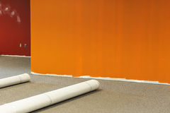 New office decoration. Carpet installation, wall paint Royalty Free Stock Images
