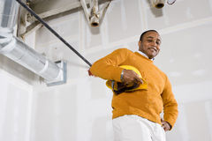 New office space. African American man in empty commercial office space ready for renovations by new tenant Stock Photos