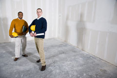 New office space. Multi-ethnic people in office space ready for renovations by new tenant Stock Photo