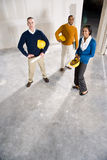 New office space. Multi-ethnic people in office space ready for renovations by new tenant Stock Images