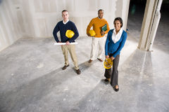 New office space. Multi-ethnic businesspeople in office space ready to be renovated for new tenant Stock Photography