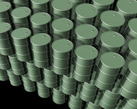 New Oil drums. New clean oil drums piled high on against a black background Stock Image
