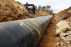 Construction site of oil pipeline. New Oil pipeline under busy construction site royalty free stock photography