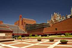 New and old. View of the courtyard of the british Library, London, with the gothic towers of St Pancras Station peeping over the top at the right. Space for text Stock Photos