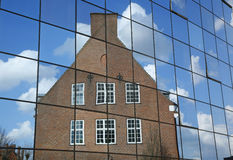 New and Old. Old hospital buildings reflect in a new modern part - Odense, Denmark Royalty Free Stock Photo