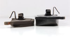 New and old brake pads Stock Image