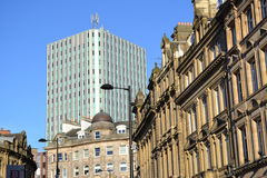 New and Old. A brand new building sits behind the older Newcastle contrasting each other Stock Photo