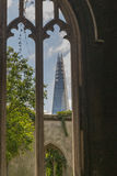 The New and The Old in Business District of London. The Shard taken through a disused old church window in the City of London Royalty Free Stock Photography