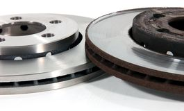 New and Old Disk Brake Rotors Royalty Free Stock Image